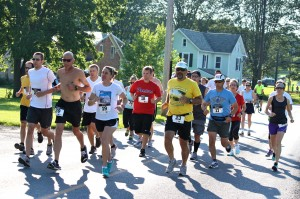 Runners and walkers leap from the start of the 3rd annual MPMC 5-mile road race on Saturday, June 15, 2013 in Mercersburg, Pa.