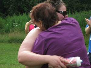 Rebekah embraces her mother, Barbara Moten, immediately after being surprised by her presence at the finish line of the 5th annual Salem Challenge 5K run on Saturday, July 20, 2013.