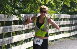 Erica Maloney gives the thumbs up as she approaches the Frostburg Depot and the Run for Gold Metric Marathon finish line.