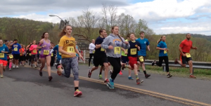 Photo by Addy Mallery Runners launch from the start line at the beginning of the 5th annual Conquer the Dam 5K at Jennings-Randolph Lake on Saturday in Elk Garden, W.Va.