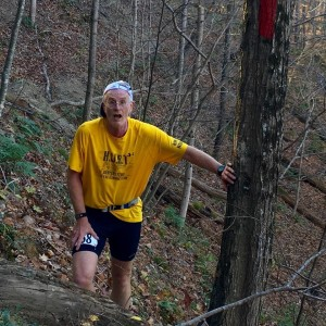 Photo by Michelle Jacoby Jack Childers, of Shepherdstown, W.Va., works his way along the red trail on the final quarter of the 32.8-mile Fire on the Mountain trail race in November 2016.